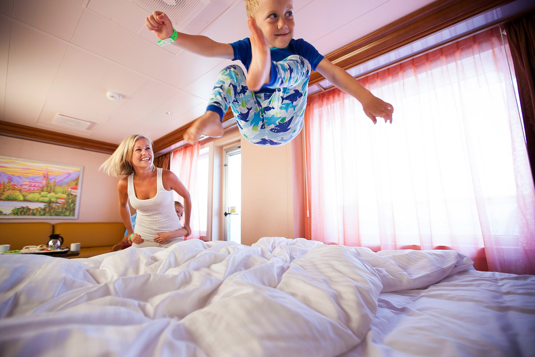Carnival-cruise_kid jumping on bed