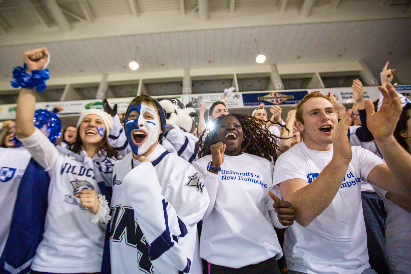 UNH hockey white out fans cheering